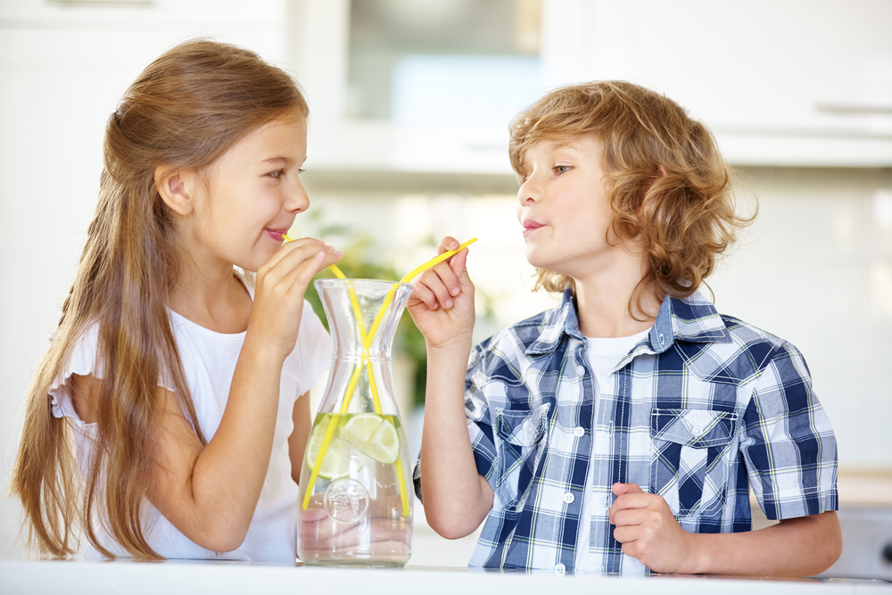 Kids drinking water with a straw